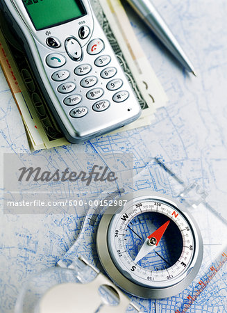 Cell Phone and Compass on Map Stock Photo - Premium Royalty-Free, Image code: 600-00152987