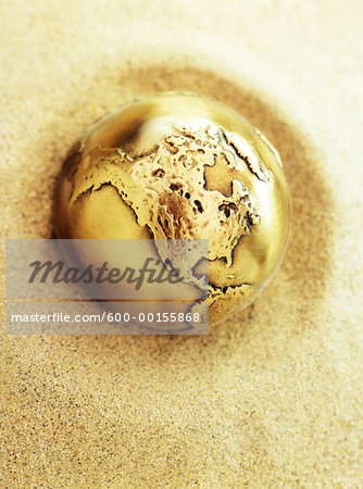 Metal Globe in Sand North America Stock Photo - Premium Royalty-Free, Image code: 600-00155868