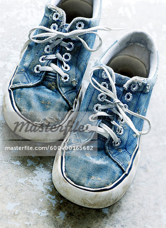 Pair of Old Sneakers Stock Photo - Premium Royalty-Free, Image code: 600-00165682