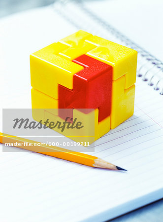 Cube Puzzle and Pencil on Notebook Stock Photo - Premium Royalty-Free, Image code: 600-00199211