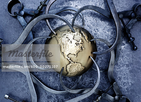 Callipers around Globe Stock Photo - Premium Royalty-Free, Image code: 600-00270107