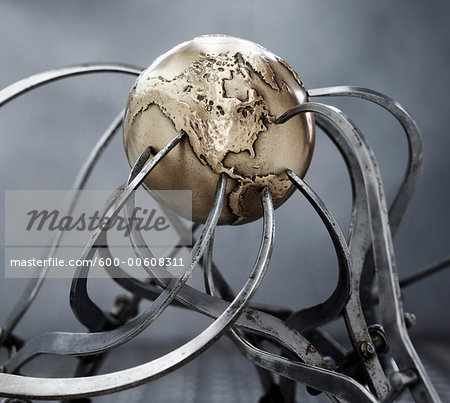 Calipers Gripping Steel Globe Stock Photo - Premium Royalty-Free, Image code: 600-00608311