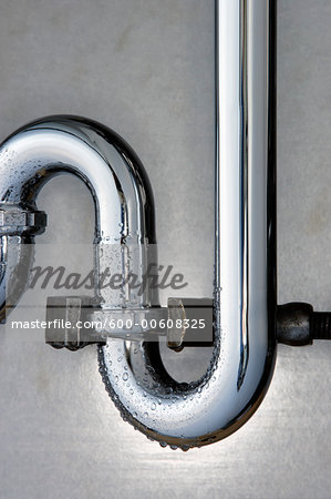 Pipe Wrench Gripping Drain Pipe Stock Photo - Premium Royalty-Free, Image code: 600-00608325
