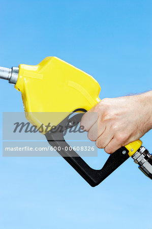 Hand Using Gas Pump Stock Photo - Premium Royalty-Free, Image code: 600-00608326