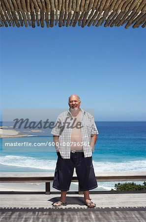 Man Standing by the Beach Stock Photo - Premium Royalty-Free, Image code: 600-00796361