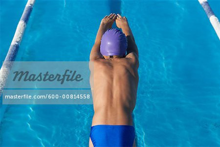 Boy Diving into Swimming Pool Stock Photo - Premium Royalty-Free, Image code: 600-00814558