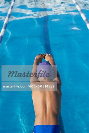 Boy Diving into Swimming Pool Stock Photo - Premium Royalty-Free, Image code: 600-00814559