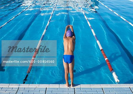 Boy Diving into Swimming Pool Stock Photo - Premium Royalty-Free, Image code: 600-00814560