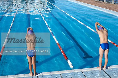 Boys Diving into Swimming Pool Stock Photo - Premium Royalty-Free, Image code: 600-00814561