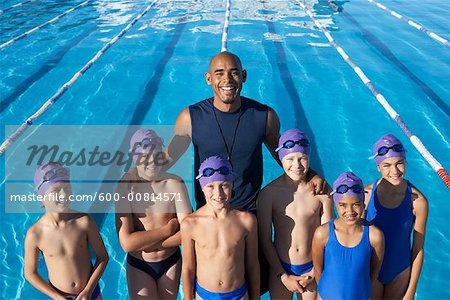 Coach and Students by Swimming Pool Stock Photo - Premium Royalty-Free, Image code: 600-00814571