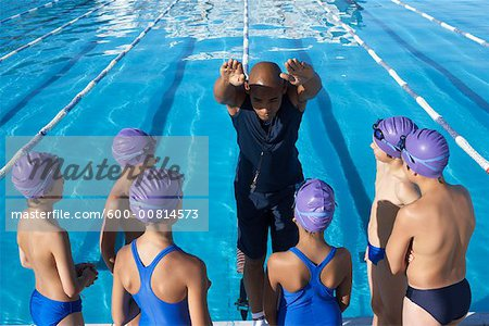 Coach and Students by Swimming Pool Stock Photo - Premium Royalty-Free, Image code: 600-00814573