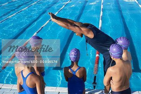 Coach and Students by Swimming Pool Stock Photo - Premium Royalty-Free, Image code: 600-00814574