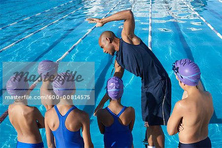 Coach and Students by Swimming Pool Stock Photo - Premium Royalty-Free, Image code: 600-00814575