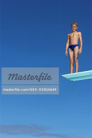 Boy on Diving Board Stock Photo - Premium Royalty-Free, Image code: 600-00814649