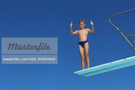 Boy on Diving Board Stock Photo - Premium Royalty-Free, Image code: 600-00814650