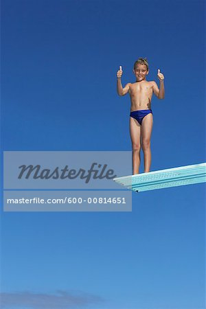 Boy on Diving Board Stock Photo - Premium Royalty-Free, Image code: 600-00814651
