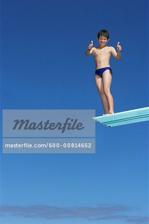 Boy on Diving Board Stock Photo - Premium Royalty-Free, Image code: 600-00814652