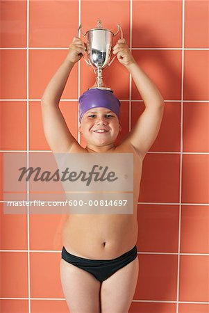 Portrait of Boy Holding Trophy Stock Photo - Premium Royalty-Free, Image code: 600-00814697