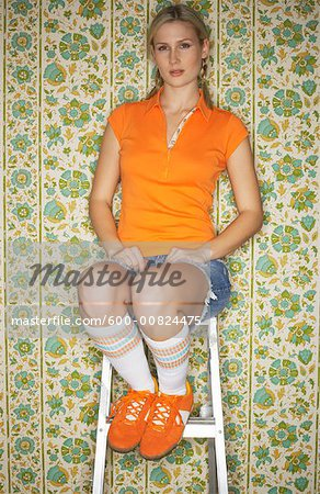 Woman Sitting on Ladder Stock Photo - Premium Royalty-Free, Image code: 600-00824475
