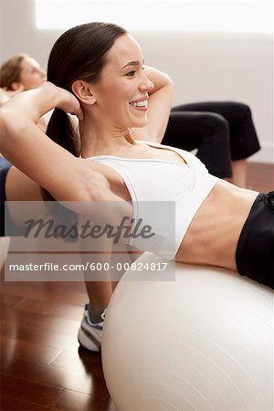Women Sitting on Exercise Balls Stock Photo - Premium Royalty-Free, Image code: 600-00824817