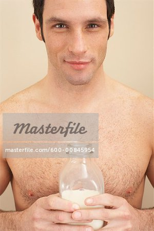 Man Holding Bottle of Milk Stock Photo - Premium Royalty-Free, Image code: 600-00845954