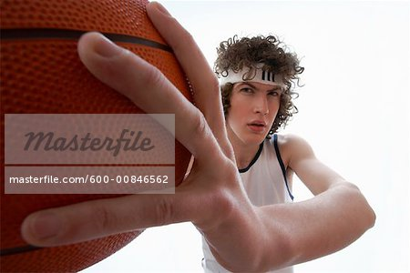 Young Man Holding Basketball Stock Photo - Premium Royalty-Free, Image code: 600-00846562