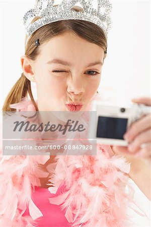 Girl Taking Picture of Self Stock Photo - Premium Royalty-Free, Image code: 600-00847928