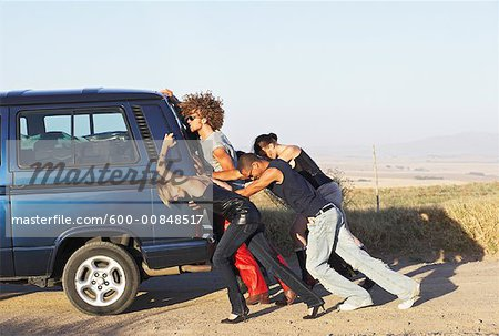 People Pushing Stalled Van Stock Photo - Premium Royalty-Free, Image code: 600-00848517