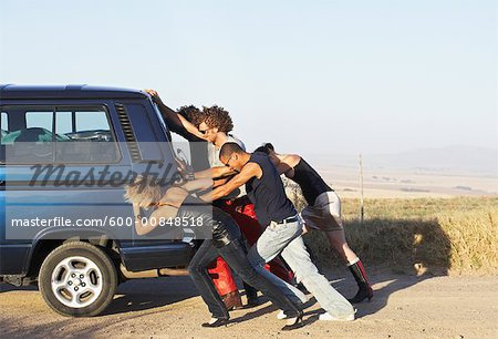 People Pushing Stalled Van Stock Photo - Premium Royalty-Free, Image code: 600-00848518