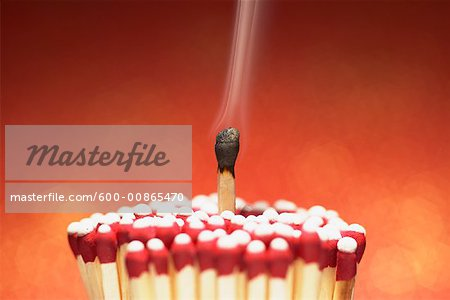 Burnt Match with Cluster of Unlit Matches Stock Photo - Premium Royalty-Free, Image code: 600-00865470