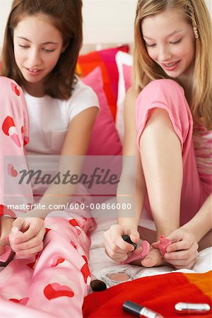 Girl's Painting Nails Stock Photo - Premium Royalty-Free, Image code: 600-00866080