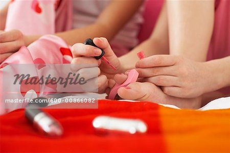 Girl's Painting Toe Nails Stock Photo - Premium Royalty-Free, Image code: 600-00866082