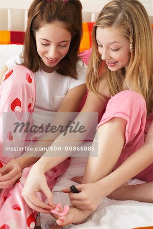 Girl's Painting Toe Nails Stock Photo - Premium Royalty-Free, Image code: 600-00866085