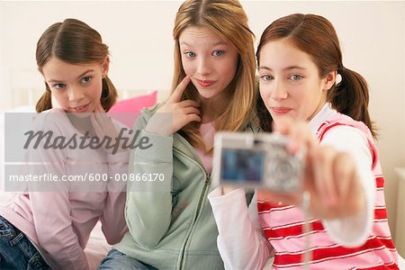 Girls Taking Self Portrait Stock Photo - Premium Royalty-Free, Image code: 600-00866170