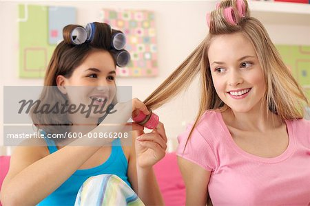 Girls Curling Hair Stock Photo - Premium Royalty-Free, Image code: 600-00866208
