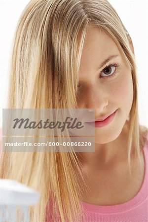 Girl Brushing Hair Stock Photo - Premium Royalty-Free, Image code: 600-00866220
