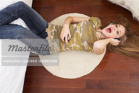 Girl in Bedroom Stock Photo - Premium Royalty-Free, Image code: 600-00866280