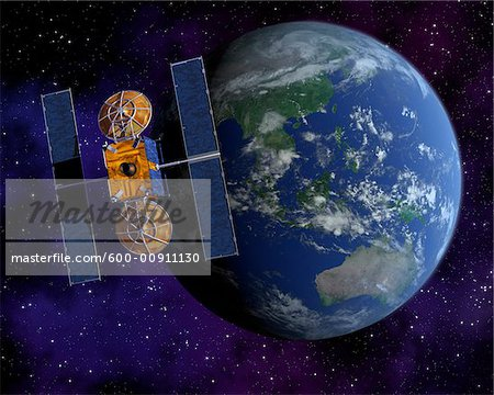 Communication Satellite Above Earth Stock Photo - Premium Royalty-Free, Image code: 600-00911130