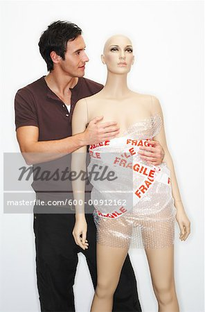 Man Carrying Mannequin Stock Photo - Premium Royalty-Free, Image code: 600-00912162
