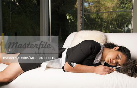 Maid Asleep On The Job Stock Photo - Premium Royalty-Free, Image code: 600-00917510