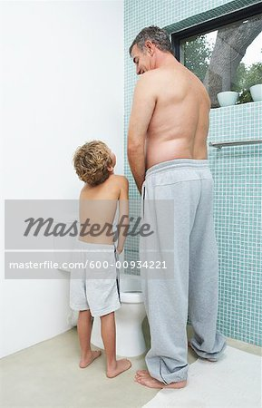 Father and Son Urinating Stock Photo - Premium Royalty-Free, Image code: 600-00934221