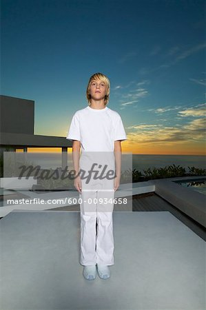 Portrait of Boy Standing on Patio Stock Photo - Premium Royalty-Free, Image code: 600-00934658