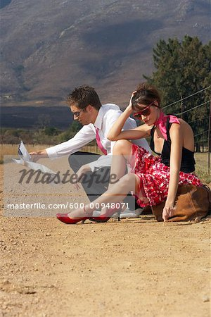 Couple Stranded On Country Road Stock Photo - Premium Royalty-Free, Image code: 600-00948071