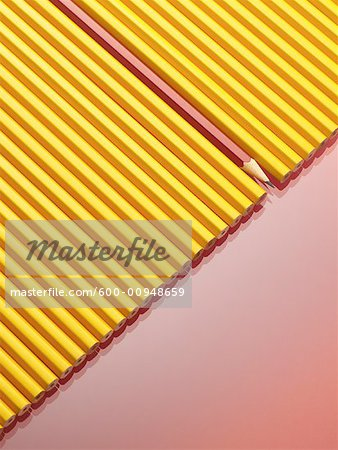Row of Yellow Pencils With One Red Pencil Stock Photo - Premium Royalty-Free, Image code: 600-00948659