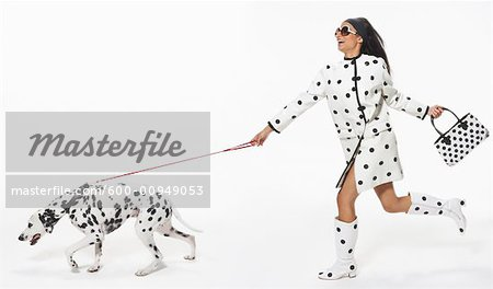 Woman Being Pulled by Dog Stock Photo - Premium Royalty-Free, Artist