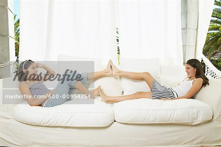 Girls Playing on Couch Stock Photo - Premium Royalty-Free, Image code: 600-00954254