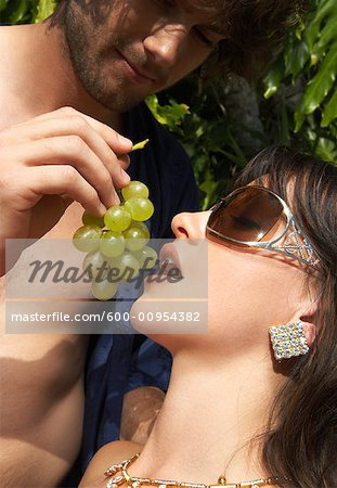 Man Feeding Woman Grapes Stock Photo - Premium Royalty-Free, Image code: 600-00954382