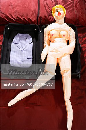 Blow-Up Doll in Suitcase Stock Photo - Premium Royalty-Free, Image code: 600-00954707