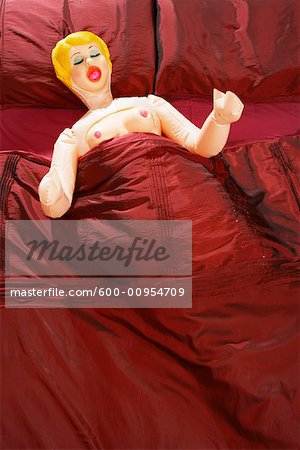 Blow-Up Doll in Bed Stock Photo - Premium Royalty-Free, Image code: 600-00954709