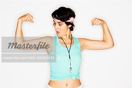 Woman Flexing Muscles Stock Photo - Premium Royalty-Free, Image code: 600-00955031